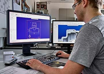 Person on PC with CAD software